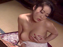 Horny amateur chick from Asia exposes her boobs to the camera