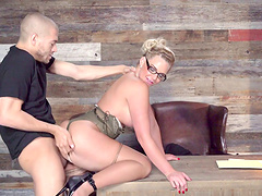 Nerdy blonde looking brutally hot during the doggy style screwing
