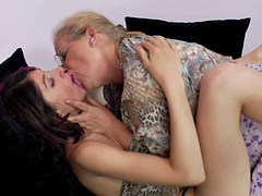 Horny granny is lucky to have her pussy licked by an attractive girl