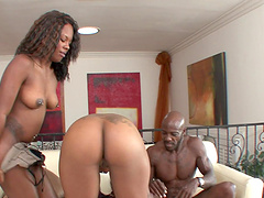 Natalie Evans and one more girl share black friend's shaft on the couch