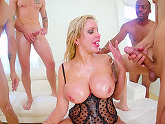 Seems like this big-boobed blonde really loves the stiff peckers!