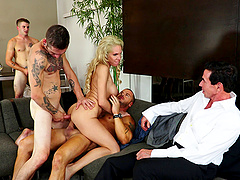Elegant blonde lady finds herself in the middle of a gangbang
