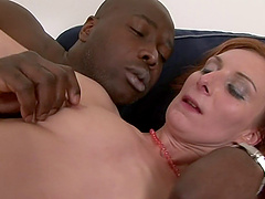 Redhead with a bushy snatch decides to taste the African penis