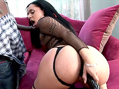 Kinky ebony babe takes on a massive dildo and a huge cock up her holes