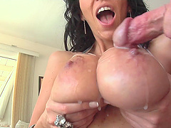 Alia Janie with big tits giving dick titjob till the guy cums