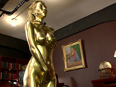 Sex slave covered in golden paint craves a stiff dong