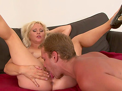 Mature Kathy Anderson masturbates before riding a boner