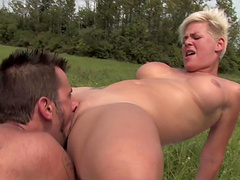 Naughty blonde lets a hung dude plow her pussy in a middle of a field