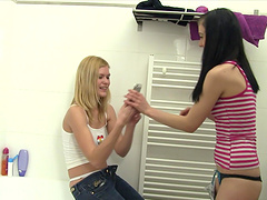 Cute lesbian babes enjoy a hot fuck during a bubble bath