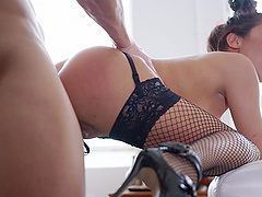 Sexy spooning with Romana Ryder who is wearing sexy fishnets