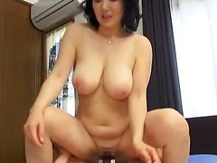 Huge-titted Asian milf gets grabbed and slammed in the pussy