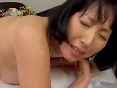 Black-haired milf from Japan lying down and getting pounded