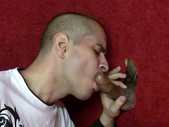 Gay cutie Kris giving a handjob to a guy coming out of a glory-hole