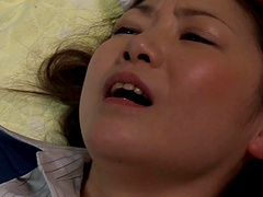 Japanese milf lying down and having her smooth pussy drained