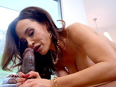 Horny Lisa Ann likes to play with a big load of black pecker