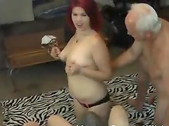 Gorgeous redhead babe finally gets to suck two delicious cocks