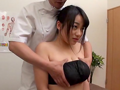 Horny guy enjoys fingering a brunette girl while he squeezes her tits