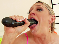 Blonde babe Dee Williams can fit a whole cock in her deep throat