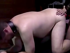 Kinky dude bends over to get his ass pounded by a strap-on toy