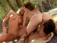 Jenny Lee and Brooke Belle share a hard cock and a cum shot outdoors