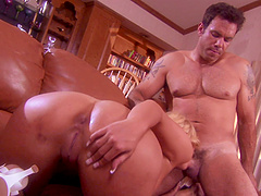 Phoenix Marie gives a blowjob and gets pounded from behind