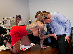 Tattooed secretary in fishnets Karma RX opens her mouth wide for cum