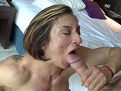 Muscular mature short haired MILF Karyn milks a cock for cum