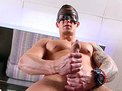 Solo masturbation and a huge cumshot from a masked solo gay dude