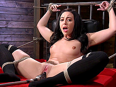 Submissive dark haired Whitney Wright abused by a machine in bondage
