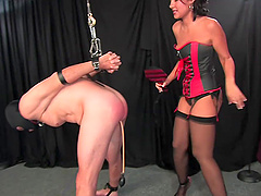 Brunette MILF Mistress Haley spanks and abuses her male slave hardcore