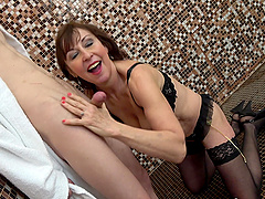 Mature short haired MILF doggy fucked in the bathroom standing up