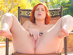 All redhead Edyn wants is to play with her pussy outdoors