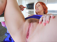 REdhead solo bombshell babe Edyn rides a big dildo on the table