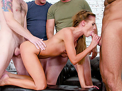 Skinny pornstar Eveline Dellai enjoys getting gangbanged by studs