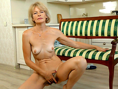 Solo MILF Diana Gold moans while playing with her hairy pussy