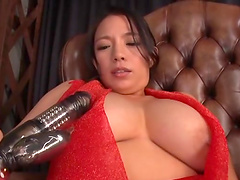 Busty Japanese model Oda Mako enjoys playing with a large toy