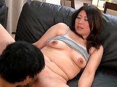 Horny Japanese cougar Yuna Shiina gets fucked on the leather sofa
