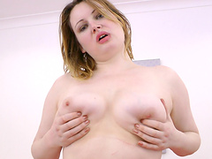 Chubby MILF Amber West moans while pleasuring her wet pussy