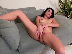 Horny solo chick Theresa Soza takes off her clothes to masturbate