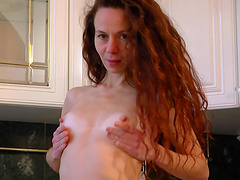 Oiled solo chick Anee Ocean pleasures her puss in the kitchen
