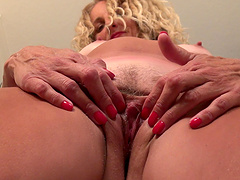 Naughty MILF Zoe Marks with tan lines, enjoys playing with her pussy