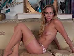 Elegant Eve drops her clothes and masturbates for the camera