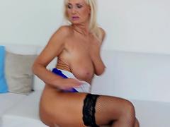 Hot ass mature Roxana Hanova pleasures her pussy on a sofa
