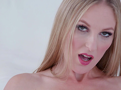 Pretty blonde babe Cam Angel makes herself cum while playing