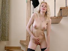 Sexy blonde MILF Sasha Jess enjoys masturbating on the stairs