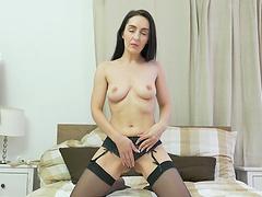 Solo cutie Di Devi in black lingerie plays with a vibrator