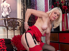 Horny solo mature Margaret Holt loves pleasuring her wet pussy