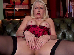 Busty mature Margaret Holt opens her legs to masturbate at home