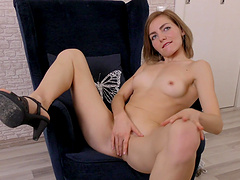 Solo cutie Judith Angel enjoys pleasuring her pussy on a chair