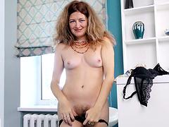 Horny MILF Helena Volga in stockings moans while masturbating